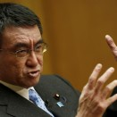 Japan's Minister for Administrative Reform Taro Kono speaks during an interview in Tokyo, Japan, December 10, 2015. Japan may review spending on reprocessing plutonium for use in nuclear reactors, a minister appointed to identify wasteful expenditure told Reuters, following years of government outlay on a controversial programme that has yield no results. REUTERS/Thomas Peter - RTX1Y2AQ