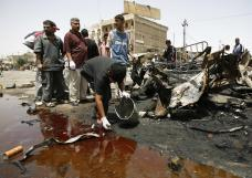 Baghdad, IRAQ: An Iraqi searches for body parts in a pool of blood and sewage at the site of a powerful car bomb which exploded in a Baghdad market, 06 May 2007. The blast sent shrapnel scything through a crowd in the Bayaa neighbourhood, a mainly Shiite district lying on one of the city's many dangerous sectarian faultlines, killing at least 20 people and wounding 45 more. AFP PHOTO / AHMAD AL-RUBAYE (Photo credit should read AHMAD AL-RUBAYE/AFP/Getty Images)