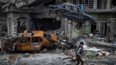 A boy rides his bike past destroyed cars and houses in a neighborhood recently liberated by Iraqi security forces, on the western side of Mosul, Iraq, Sunday, March 19, 2017. The battle for western Mosul, including the narrow alleyways of the old city, looks to be the most devastating yet for Iraqi civilians trapped between advancing troops and increasingly desperate Islamic State militants. An estimated 750 civilians have been killed or wounded since the push to retake the western half of the city began in late January, and more than 100,000 have fled. (AP Photo/Felipe Dana)