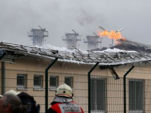 Firefighters are seen at the largest natural gas import and distribution station after a gas explosion in Baumgarten, Austria December 12, 2017 REUTERS/Heinz-Peter Bader - RC1B0B67C9E0
