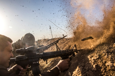 October 17, 2016: Badana Pichwk, Iraq: Peshmerga troops fire at ISIS positions as they move toward Mosul. (Bryan Denton/The New York Times/Redux)